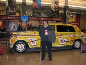 Anthony Towstego standing in front of John Lennon's legendary vehicle