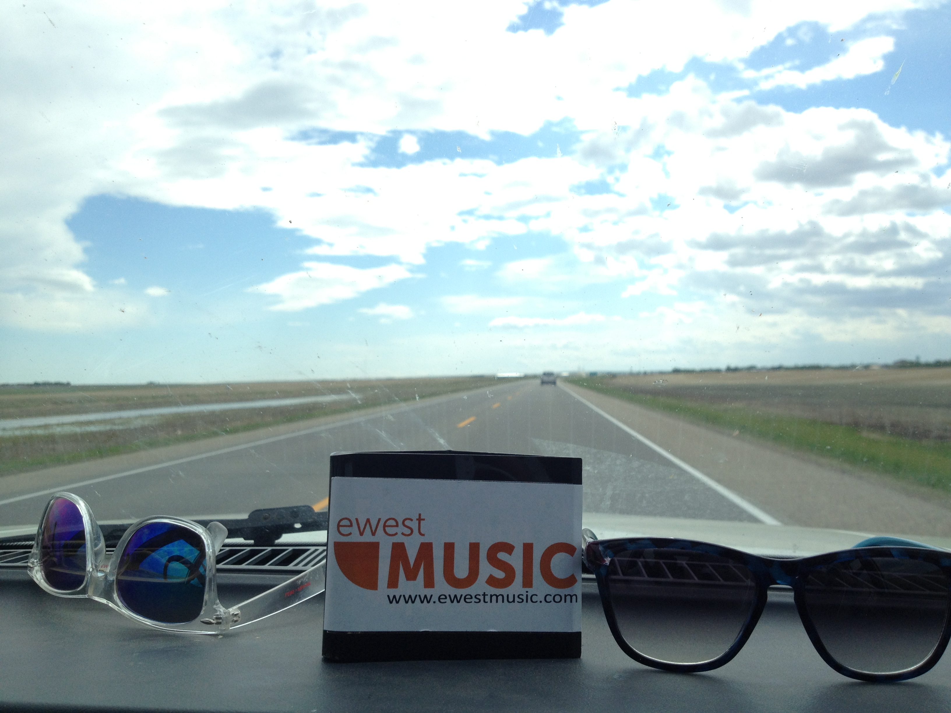 EWest Music driving through the Great Plains of Saskatchewan... (Side Note, apparently you can never have enough sunglasses in a vehicle... At one point I counted 6 on the dashboard)